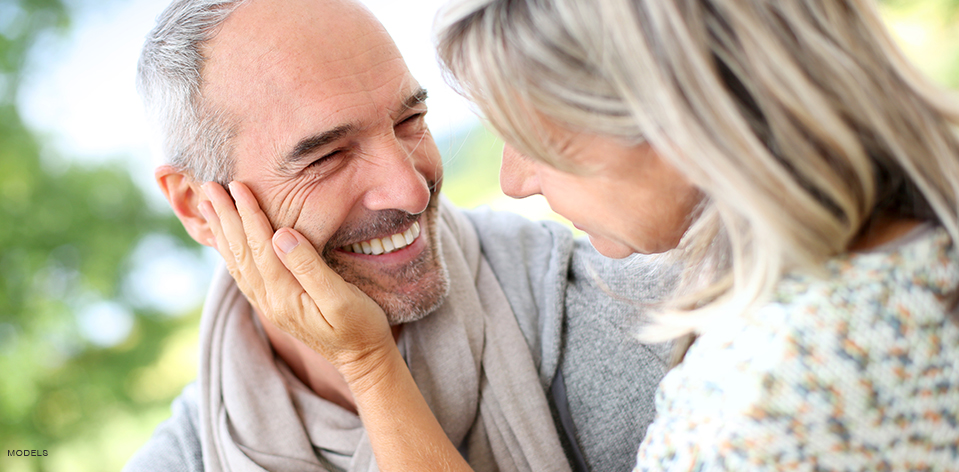 Mature Couple Looking At Each Other Smiling