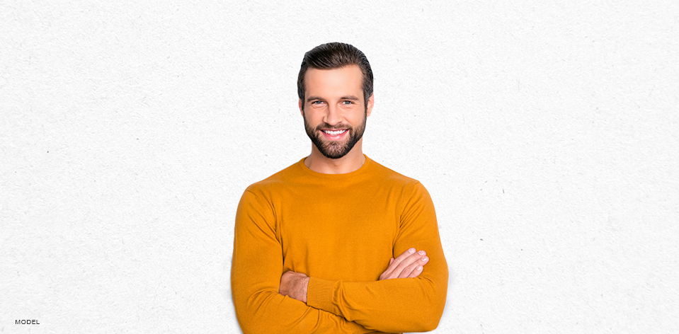 Handsome Middle Aged Smiling Man in Yellow Sweater