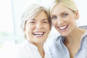 Mature Woman And Young Woman Smiling