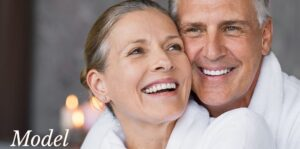 Mature Couple Smiling and Touching Cheeks Together